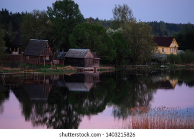Landscape with the image of village on lake Seliger in Russia