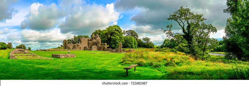 Landscape of Inch Abbey in Northern Ireland. Monastery ruins in Downpatrick. Co. Down. Travel by car in summer.