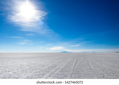 Landscape of incredibly white salt flat Salar de Uyuni, amid the Andes in southwest Bolivia, the world's largest salt flat scene with blue sky in sunny day and Copy space