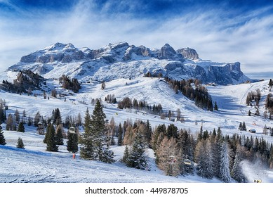 Landscape of the italian alps in a winter morning with clouds at the horizon, Dolomites Alta Badia