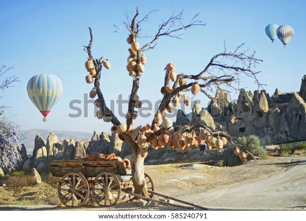 Landscape with jugs on a tree and old wagon full of clay pots, Cappadocia in Turkey