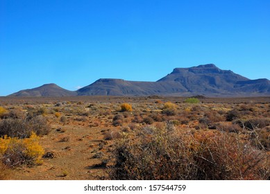 Landscape of the Karoo in South Africa showing the Hantam mountains viewed from the little town of Calvinia in the Northern Cape during a dry summer season.
