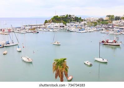 landscape of Kastella Piraeus Greece - greek harbor with fishing boats and sailboats