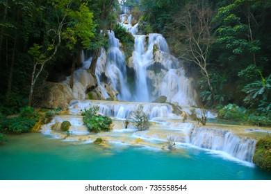 Landscape of Kuang Si Fall or Tat Kuang Si the beautiful limestone water fall in Luangprabang, Laos soft focus.