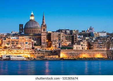 Landscape of la Valetta in Malta at night.