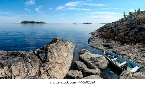 Landscape of Ladoga lake with boat parked in a narrow bay at the side of Lapinsaari island, Republic of Karelia, north-west of Russia