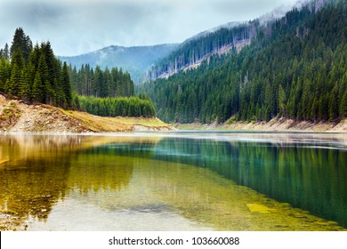 Landscape with lake Galbenu in Parang mountains in Romania