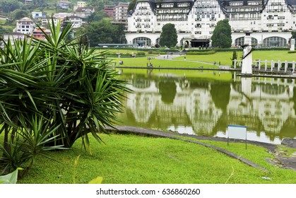 Landscape of lake and garden leisure park - in the background Quitandinha Palace in Petropolis