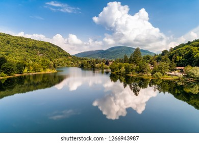 Landscape of Lake Ghirla with reflections of the clouds, Valganna in Province of Varese, Italy