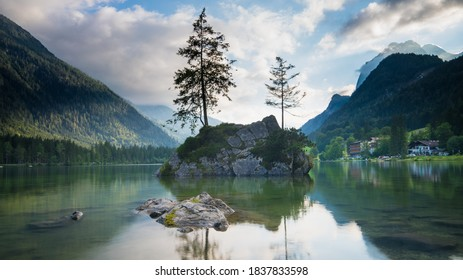 landscape of the lake hintersee, on a cloudy day. And a lot of reflections in the water.