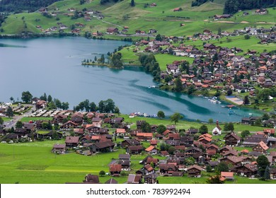 A landscape of Lake Lungern, Switzerland on a cloudy day.