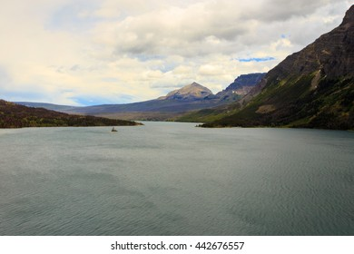 Landscape of Lake McDonald with mountains in background. Glacier National Park.