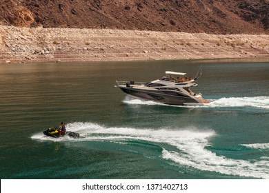 Landscape of Lake Mead with boat and water scooter on high speed