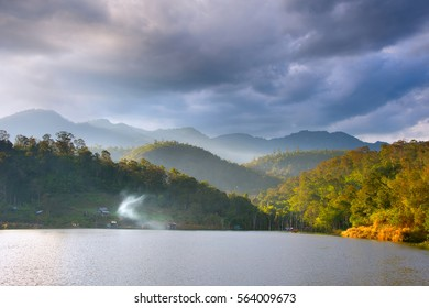 Landscape with lake, mountains and beautiful clouds. Nothern Thailand. Pai