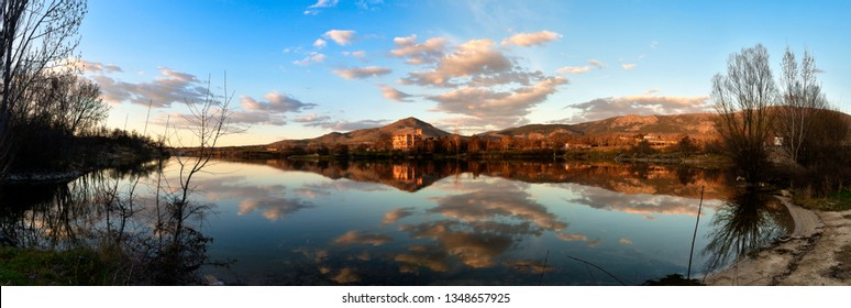 Landscape with lake and mountains of old Europe at sunset