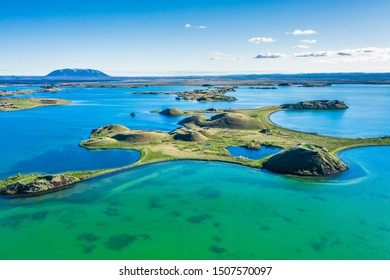 Landscape of Lake Myvatn with green pseudocraters and islands at.Popular tourist destination in north of Iceland, Europe