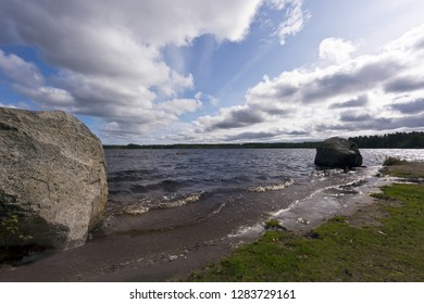 Landscape with a lake and the sky in late summer. Böles-Noran lake, Sweden
