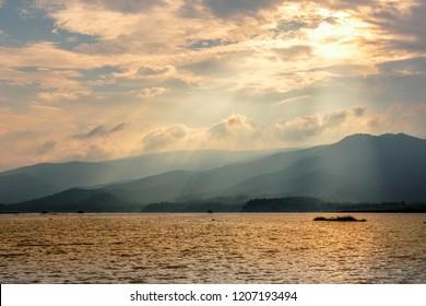 landscape of lake sunlight on clound background