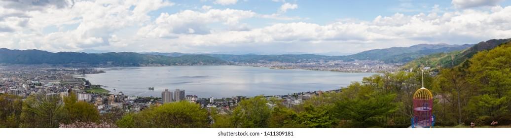 Landscape of Lake Suwa and Suwa City in Nagano, Japan.