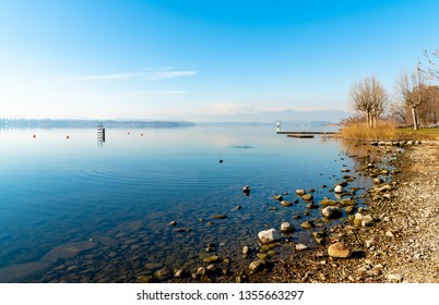 Landscape of Lake Varese in a clear winter sunny day, Italy
