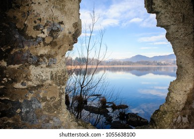 landscape of Lake Varese, through a broken wall,Varese,Lombardy,Italy
