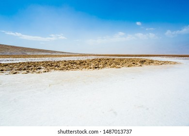 Landscape of land covering with salt pan in Badwater Basin, the lowest point of the North America, Death Valley National Park, California, USA