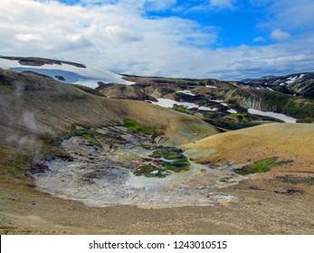 Landscape of Landamannalaugar geothermal area with vivid rhyolite mountains, black lava fields, snow and poor vegetation, Fjallabak Nature Reserve, Highlands of Iceland