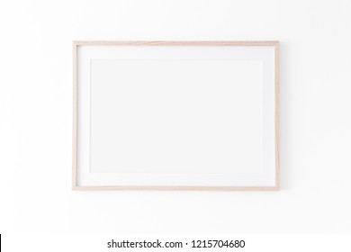 Landscape large 50x70, 20x28, a3,a4, Wooden frame mockup with passe-partout on white wall. Poster mockup. Clean, modern, minimal frame. Empty fra.me Indoor interior, show text or product
