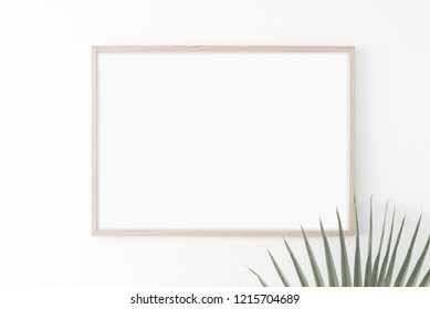 Landscape large 50x70, 20x28, a3,a4, Wooden frame mockup on white wall. Palm leaves. Poster mockup. Clean, modern, minimal frame. Empty fra.me Indoor interior, show text or product