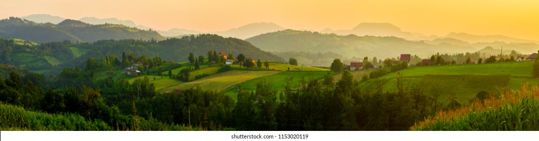 Landscape large panorama of serbian village at summer evening. Beautiful sunset with mountains in background. Serbia, Europe.