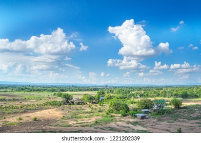 Landscape of large wide empty land plot for industrial development, real estate or housing construction project in rural area with green environment, beautiful blue sky Land allocation for sales