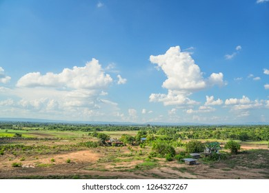 Landscape of large wide empty land plot for industrial development, real estate, housing construction project in rural area with green environment and beautiful blue sky  Land allocation for sales
