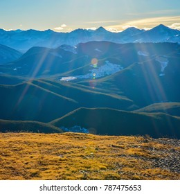 Landscape with lens flare of Kananaskis Mountains and Foothills from Prairie Mountain near Bragg Creek, and Calgary, Alberta, Canada