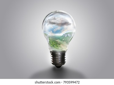 the landscape in the light bulb isolate on white gray background