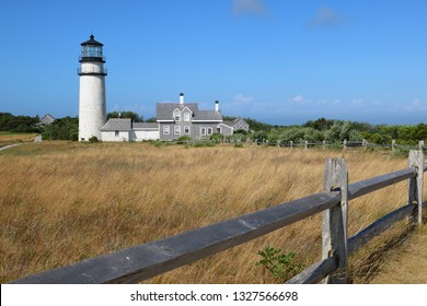 Landscape with lighthouse and out buildings near a field by the sea