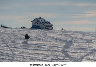 Landscape to a lodge at Monte Pora ski area in winter season. Orobie Alps. Italy