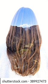 Landscape in long hair of a woman. Double exposure taken with the camera.