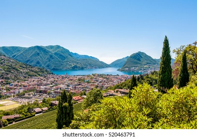 Landscape of Lugano lake, mountains and the city located below, Ticino, Switzerland