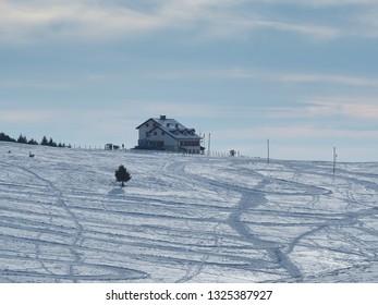 Landscape to the Magnolini lodge at Monte Pora ski area in winter season. Orobie Alps. Italy