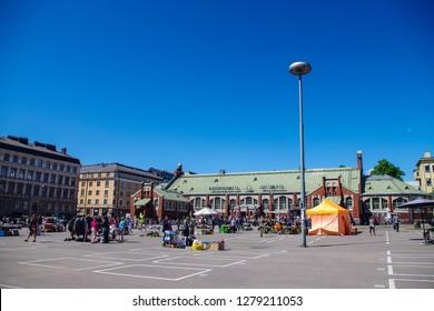 Landscape of a market place in Sandvikstorget, people are shopping in Hietalahden tori, Helsinki, Finland, 02.06.2018