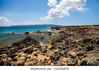 Landscape of the Mediterranean coast in an island, with rocks, sea and a sky with some clouds