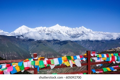 Landscape of Meili Snow Mountain with many praying flags in Yunnan. Meili Snow Mountain is located about 10 kilometers north-east of Deqin County in Yunnan Province, China.