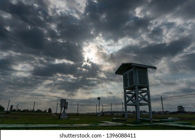 A landscape of Meteorological garden in the morning when the sky full grey cumulus and cirrus clouds with beautiful ray of light from the sun