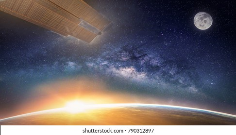 Landscape with Milky way galaxy. Sunrise, Earth, moon and satellite view from space with Milky way galaxy. (Elements of this image furnished by NASA)