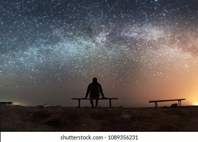 landscape with milky way and human - Shutterstock ID 1089356231