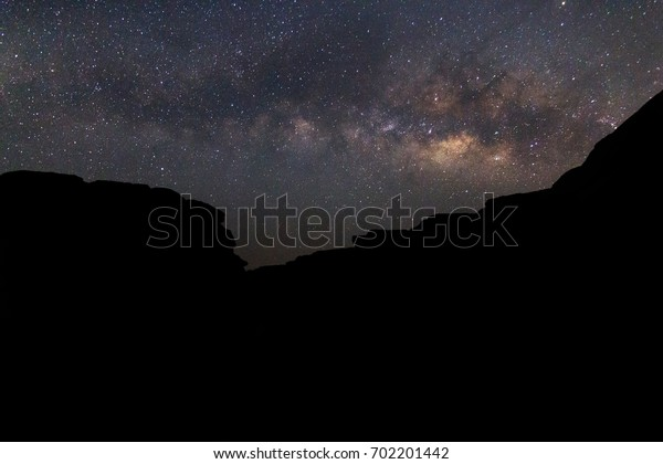 Landscape Milky Way on the night sky.Mountain at night with bright light of the stars across the sky