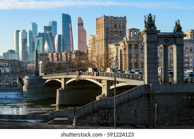 Landscape of modern Moscow city skyscrapers and ancient city architecture. Fantastic view of Borodinsky bridge on river Moscow, old buildings and high towers of Russia capital downtown. Moscow, Russia