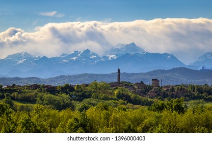 Landscape of the Monferrato hills with the Alps as a background. Telephoto from Don Bosco Hill in the province of Asti, Italy. Far away on the right you can see the Basilica of Superga.