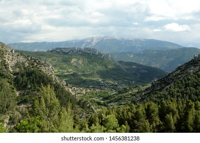 Landscape of the Mont Ventoux, Ventoux mountain. In the foreground mountains, a village. A cloudy sky. Spring in France, Provence.