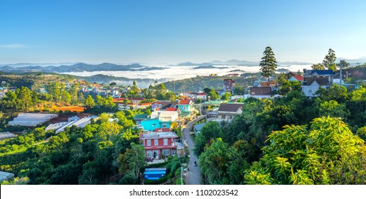 Landscape morning in small village in the valley on the plateau, distant fog shrouded the great hidden house on the outskirts of Dalat, Vietnam